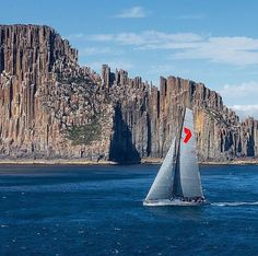 Wild Oats XI (@wildoatsxi) passing Tasmania's iconic organ pipes in Rolex Sydney to Hobart Yacht Race 2013 Photo credit : Carlo Borlenghi / @carlo.borlenghi  #sailing #yachting #sails #sail #northsails #wind #waves #sailboat  #instasailing  #yacht #sport #racing #yachtracing #crew #sailingstagram #superyacht #maxiyacht #secretsailing #supermaxi #woxi #wildoats #wildoatsxi #rshyr #rshyr2013 #sydneyhobart #sydneytohobart #rolexsydneyhobart
