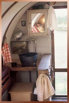 #2 - fishingcamp; in a custom made wagon/camper; very cute; love the decor.....   interior-02c.jpg (21674 bytes)
