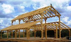 There are some types of roof that would create a traditional house style and a gambrel roof is one of them. A gambrel roof is a symmetrical two-sided roof that has two slopes on each side of the ro… Pole Barn Garage, Pole Barn House Plans, Pole Barn Homes, Barn Plans, Pole Barns, Casas Cordwood, Pole Barn Designs, Barn Kits, Gambrel Roof