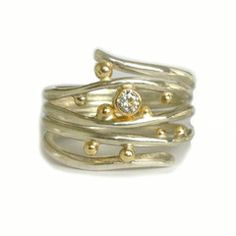 Wave ring : ocean inspired sterling silver ring with 18kt yellow gold details and bezel set Moissanite.