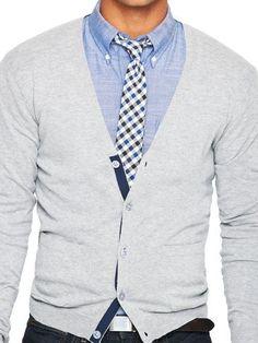Shop this look on Lookastic:  https://lookastic.com/men/looks/cardigan-long-sleeve-shirt-skinny-jeans/14378  — Light Blue Chambray Long Sleeve Shirt  — White and Navy Gingham Tie  — Grey Cardigan  — Dark Brown Leather Belt  — Black Skinny Jeans
