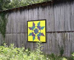 Quilt Barn    Location:  On Chester and Judy McDaniel's barn on Hwy 131  Grainger Co - TN  Latitude:N/A  Longitude:N/A  MapApprox    Notes:  Feathered Star pattern:  Photo by Candy Barbee  painted by Washburn H.S. art students