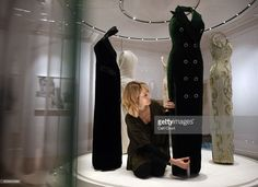 A member of staff poses with a 1992 Catherine Walker green silk velvet evening dress with velvet and diamante buttons worn for Diana's Vanity Fair photo shoot with Mario Testino in 1997 during a preview for the forthcoming 'Diana: Her Fashion Story' exhibition at Kensington Palace on February 16, 2017 in London, United Kingdom.On August 31st this year it will be 20 years since Princess Diana died in a car accident in Paris. As part of the events commemorating her life Kensington Palace are…
