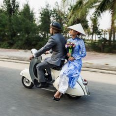 Vietnam, young couple riding along on classic Vespa