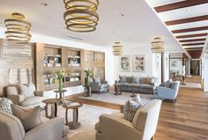 Display unit, chandeliers and side tables at Rupert  Rothschild all custom made in French Oak by Pierre Cronje.