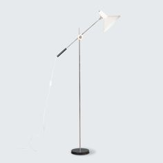 DUTCH WHITE METAL FLOOR LAMP BY ANVIA, 1950S line Stunning and rare white floor lamp by Anvia, Netherlands. Produced in the 1950s, this piece is in excellent condition and has been rewired to Australian standards. Featuring a lacquered metal lamp shade and chrome stand and adjustable arm, this lamp is the quintessential industrial lamp for the modern space. White Floor Lamp, Metal Floor, Mid Century Lighting, Modern Times, Modern Spaces, Netherlands, Dutch, 1950s, Chrome