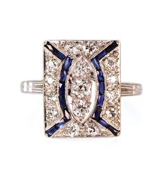 Gorgeous 1920's diamond dinner ring with rectangular scissor cut synthetic Sapphires and 0.50 carat in Old European cut diamonds. Independent Appraisal Value: $4,650.00
