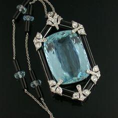 Platinum and Aquamarine Necklace Consisting of a 38.00 Carat Fancy Cut Aquamarine Pendant Surrounded by Round Brilliant Cut Diamonds and Black Onyx