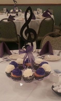 Cupcake centerpieces with musical notes for high school music banquet.