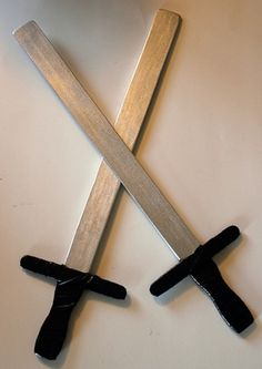 swords made with paint sticks, craft sticks, a little paint and duct tape.
