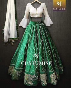 )nline Shopping of White and green Croptop lehenga Choli From Mongoosekart, Huge Collection of Latest Lehenga Designs Available here Indian Gowns Dresses, Indian Fashion Dresses, Dress Indian Style, Indian Designer Outfits, Half Saree Designs, Fancy Blouse Designs, Dress Designs, Indian Lehenga, Bollywood Lehenga
