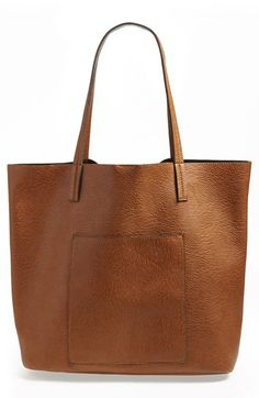 Free shipping and returns on Street Level Faux Leather Pocket Tote at Nordstrom.com. A smooth patch pocket complements the clean, simple silhouette of a cool shoulder tote made from lightly textured faux leather . A spacious interior seals the deal on this endlessly versatile throw-in-and-go style.