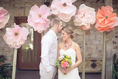 Using huge paper flowers in your wedding decor makes a great photo prop!