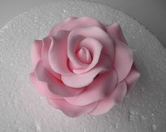 "Learn how to make a sugar rose out of gum paste with this rose tutorial. I use one or two sizes of petal cutters when making sugar roses. The sizes of cutters generally depends on the size of the ""rose"" cones that I am making. Frosting Flowers, Fondant Flowers, Sugar Rose, Sugar Flowers, Cupcakes, Cupcake Cakes, Cake Decorating Tutorials, Cookie Decorating, Petal Dust"