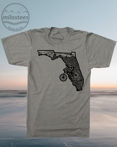 MTB T-shirt by Milostees- Ride the Alafia River in a silky tee with original FL graphic. Screen printed in the US on soft cotton, polyester tees for watching Dolphin games or relaxing on South Beach. Elevate the day wear a more comfortable you! $21.99, free shipping in the USA. #FloridaTee #FloridaGift