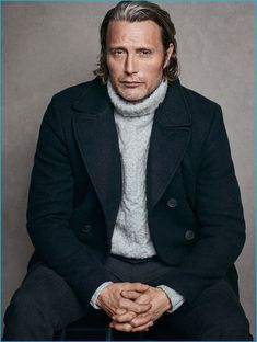 Mads Mikkelsen wears a cableknit turtleneck sweater with a peacoat for Marc…