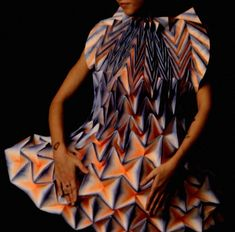 German designer Jule Waibel has created 25 of her folded paper dresses for fashion brand Bershka's shop windows around the world