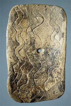 Three snakes. Snakes are rare in northern hemisphere Paleolithic art. Mammoth tusk; carved, polished and engraved. 138 x 81 mm.   Malta Site (excavations by M.M. Gerasimov, 1928-1930), Siberia, the River Belaya, near Irkutsk, Russia   Maltinsko-buretskaya Culture. 23 000 - 19 000 BP   Photo and text: http://www.hermitagemuseum.org/