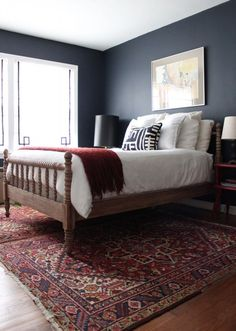 Bedroom: Hale Navy paint, stripped Jenny Lind Bed, white bed linens, ikea pillow, black lampshade, DIY greek key roman shades from miniblinds, red side table, oriental rug, double rugs