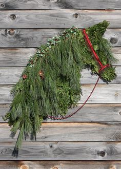 another horse head wreath :-) tis the season chicken wire frame that i fold and cut and then stuff with cedar and white pine for the mane and forlock and decorate :-) Cowboy Christmas, Country Christmas, All Things Christmas, Christmas Holidays, Christmas Wreaths, Merry Christmas, Happy Holidays, Horse Head Wreath, Holiday Crafts