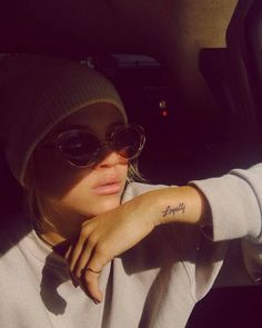 """Loyalty"" tattoo on the left side of the wrist."