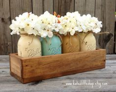 Add a gorgeous rustic planter box with 5 painted mason jars to your home or office décor. This beautiful set is the perfect addition to your rustic or country décor, and can be customized with any color jar combination you would like. The planter box is made of hand-picked, high quality white pine. Its natural knots add individual character and rustic appeal. Each jar is hand painted, distressed, and sealed to give them lasting beauty. Check out our awesome customer reviews and sales for…