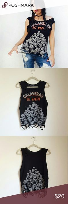 "Vtg reworked grunge distressed skulls pile tank ""Calaveras del montón"" / ""bunch of skulls"" grunge tank top. Size 12 in kids. Fits like xs/s in woman jrs.  I got excited with the scissors with this one. Really badass looking, print of a pile of skulls at front and back.  No trades  Cool discounts on bundles    Tags Retro vintage re-worked customised custom hand made one of a kind goth grunge skeletons skulls goth dark demonia Vintage Tops Tank Tops"