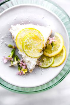 This lemon lime coconut vegan cake is easy to make and topped with fluffy whipped coconut cream frosting. A citrus flavored gluten free vegan cake that's perfect for Any season. So simple to make! All you need are a few ingredients to bake this cake in under 45 minutes.. #vegan #cake #glutenfree