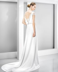 6029 wedding dress from Jesus Peiro wedding dresses Nanda Devi Collection - Gorgeous sleek wedding dress with open back detail - see the rest of the collection on www.onefabday.com
