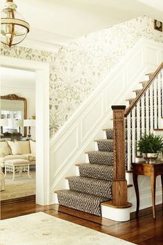 ML Interior Design | lovely neutral entry with staircase and tone on tone wallpaper