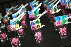 Shot glasses filled with M's were used as place cards with different Andy Warhol type photos of the Bat Mitzvah girl.