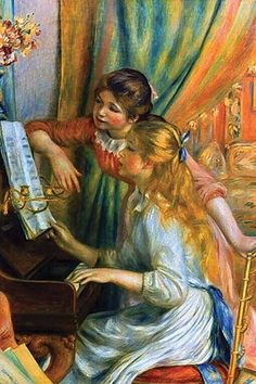 Two teenage girls examine the music score on the piano, one seated and one standing