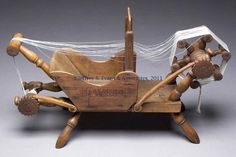 FINE PENNSYLVANIA TURNED AND CARVED WOOD TAPE LOOM, the bed mounted with a box having cut-out sides and rosehead-nail construction, and inscribed DW 1814 on one side.