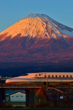 Mount Fuji and Bullet train during golden hours at Fuji-shi, Shizuoka ,Japan.We were in that train passing the same spot many times.  My husband is from Shizuoka, Japan.