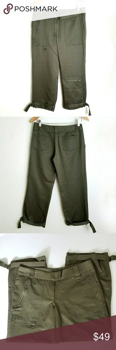 Miss Me Olive Cargo Capri Miss Me Olive Cargo Capri. Zipper and D ring details. Off seam pockets at hip. Below knee zip pocket. Belt loops. Adjustable at ankle. Slight satin sheen. Buyton/ closure. EUC  Waist 16 Rise 8.5 Inseam 25  No trade or P.P. Reasonable offers considered Bundle discounts Miss Me Pants Capris