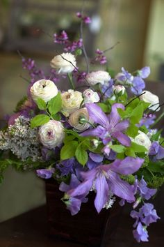 Lilac and clematis Lilac Wedding Flower Ideas and Inspirations. I have never seen clematis in an arrangement before! It reminds me of my grandma