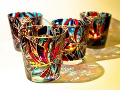 Hand painted glass candle holder by Natalia Khalaman $18.00