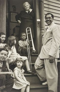 Cab Calloway with kids and the winner of the Calloway Quizzical, Providence, Rhode Island, 1938