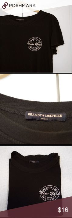 """Brandy Melville New York Top Super soft black t-shirt! It has only been worn once and in perfect condition. The shirt reads """"You haven't lived until you die in New York."""" Technically one size but will fit sizes S-M. I'm open to negotiations but will not trade. Every order comes with free Brandy Melville stickers! :) Brandy Melville Tops Tees - Short Sleeve"""