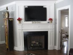 corner fireplace designs with tv above - Would use this setup minus the fireplace and put a window seat by the windows. Corner fireplace with warm cherry wood mantel. Fireplace Molding, Tv Above Fireplace, Build A Fireplace, Fireplace Mantle, Fireplace Design, Fireplace Ideas, Mantle Ideas, Bedroom Fireplace, Fireplace Remodel