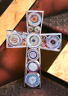 This cross, made from rolled recycled magazine paper, is made by Mai Handicrafts in Vietnam, which was started by two social workers who were concerned about improving the lives of street children and single mothers.
