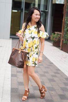 Yellow summer print dress paired with brown wedges for brunch