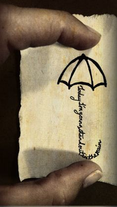 """Umbrella tattoo idea. But instead of this phrase it would say """"Hanging By a moment""""  It represents my last year of dance in High school."""