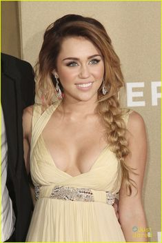 Hair is FLAWLESS! I've never seen Miley more beautiful.