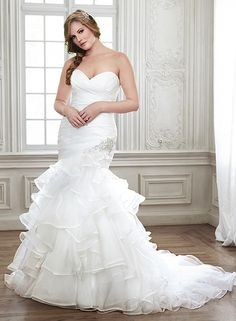 Tiers of fluted Chic Organza make a gorgeous entrance for the fashion-forward bride in this fit and flare wedding dress, Cheyenne by Maggie Sottero. Finished with Swarovski crystals and sweetheart neckline.