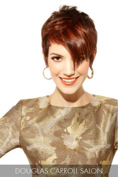 Sweeping bangs cross the brow on an angle, lengthening into an exaggerate point, for a dynamic style that redefines the pixie cut.