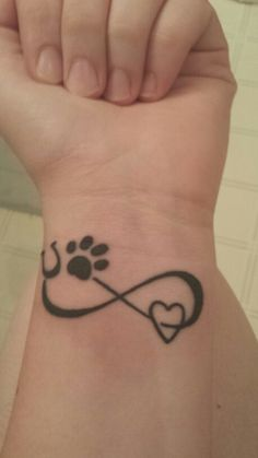 New tattoo. Paw print, horse shoe, heart and infinity sign