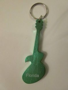 Florida Bottle Opener Rock 'N' Roll Style (Green) by Forgot My Souvenirs. $3.95. Rock 'N' Roll Bottle Opener. Rock 'N' Roll through through the Florida night with this Rock 'N' Roll Bottle Opener.  -Guitar Shaped  -Green  -Florida  -Can be used as a key chain.  -Aluminum with anodized color.