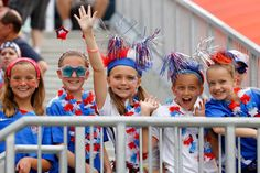 Adorable United States fan strike a pose as they cheer on the Women's National Team during the FIFA Women's World Cup game against Australia on June 8, 2015.