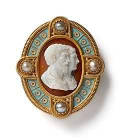 Gold, Enamel & Hardstone Cameo Brooch by Castellani,  the central oval shaped cameo carved from agate with the profiles of Jupiter & Juno, the Roman King & Queen of the Gods. The cameo is mounted within a gold border, decorated with squares of light blue enamel centred by circles of white & black. The frame further highlighted with four pearls within a rope twist border., Rome, circa 1880
